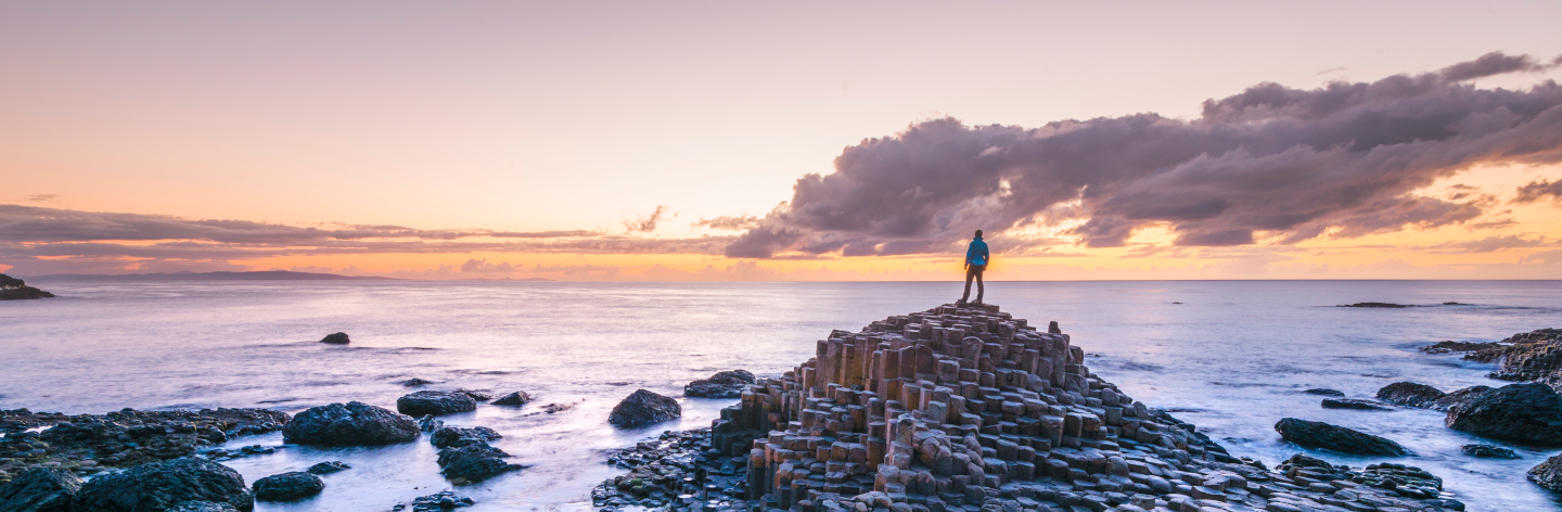 Tourist At The Giant's Causeway, Northern Ireland.